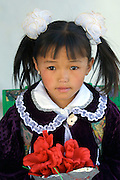 GOBI DESERT, MONGOLIA..09/03/2001.Bayanhongor (Bayankhongor). School girl during her first day back in school after summer vacancies..(Photo by Heimo Aga).