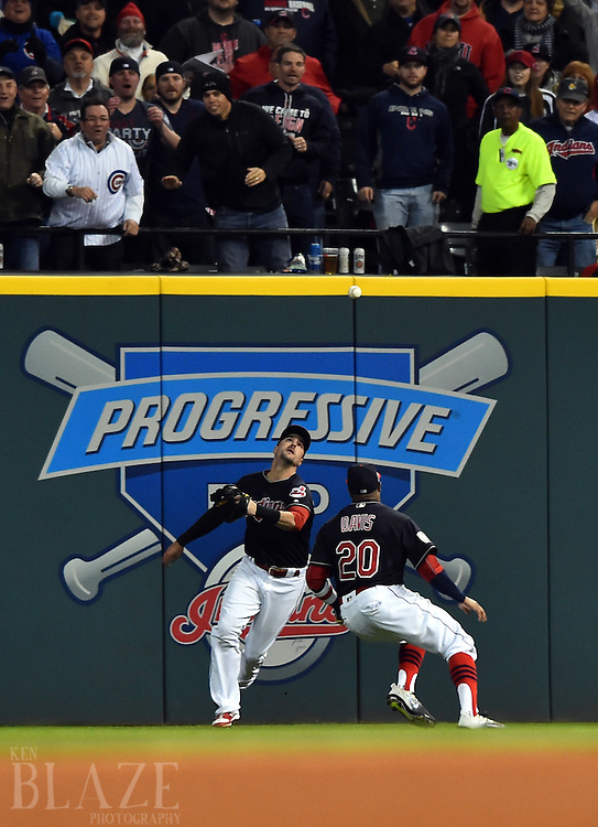 Oct 25, 2016; Cleveland, OH, USA; Cleveland Indians players Rajai Davis (20) and Lonnie Chisenhall chase a double hit by Chicago Cubs player Kyle Schwarber (not pictured) in the fourth inning in game one of the 2016 World Series at Progressive Field. Mandatory Credit: Ken Blaze-USA TODAY Sports