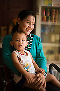 28 JUNE 2006 - SIEM REAP, CAMBODIA: A woman and her child in the guest house (small hotel) they own in Siem Reap, Cambodia. Photo by Jack Kurtz / ZUMA Press