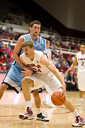 November 6, 2009; Stanford, CA, USA;  Stanford Cardinal forward Andrew Zimmermann (34) dribbles past Sonoma State Seawolves guard Mike Nelson (32) during the first half of an exhibition game at Maples Pavilion.