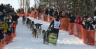 Nicolas Petit and his team leave Willow Lake after starting the 2013 Iditarod. (Stephen Nowers photo)