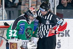 Jan Chabera (HDD Tilia Olimpija, #32) and referee Thomas Berneker during ice-hockey match between HDD Tilia Olimpija and HK Acroni Jesenice in 41st Round of EBEL league, on Januar 23, 2011 at Hala Tivoli, Ljubljana, Slovenia. (Photo By Matic Klansek Velej / Sportida.com)