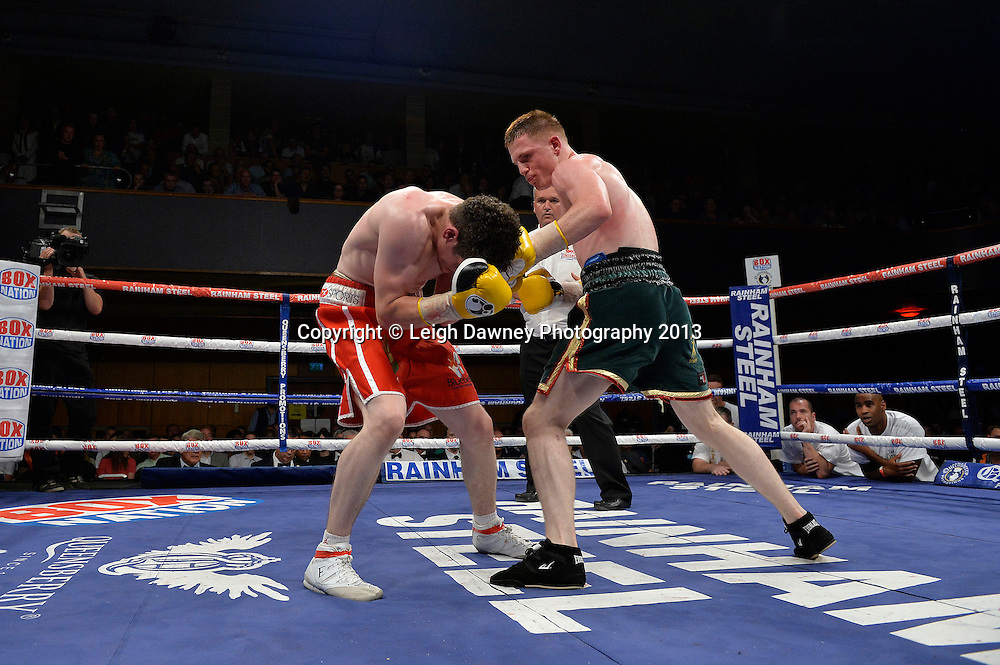 Joe Costello (bottle green shorts) defeats Lee Connelly in a Lightweight contest at Wolverhampton Civic Hall, Wolverhampton, 1st August 2014. Promoted by Frank Warren in association with PJ Promotions. © Credit: Leigh Dawney Photography.