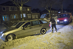 © Licensed to London News Pictures . 24/03/2013 . Burnley , UK . A helpful van driver tows a stranded vehicle from the snow on Halifax Road . Snowdrifts are making roads impassable around Burnley overnight (23rd/24th March) as high winds blow snow across roads . Plummeting temperatures and treacherous conditions are reported to have taken the life of a man named locally as Gary Windle . Lancashire Police reported finding a 27 year old man dead in deep snow yesterday (23rd March) afternoon . Photo credit : Joel Goodman/LNP