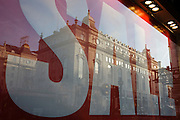 A Sale poster in Lillywhites window and reflected Regency architecture of nearby buildings  in central London.