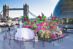 More London Place, London, March 3rd 2016. A jelly-themed, adults-only bouncy castle which has been created to celebrate the launch of Candy Crush Jelly Saga, opens on London's Southbank. The multi-sensory bouncy castle especially designed for grown-ups,  marks the latest instalment of the new mobile game, Candy Crush Jelly Saga. The bouncy castle brings to life elements of the jelly-themed game and will be open to the public for free. The castle, which appears to be made up of cubes of lime and raspberry jelly, will encompass a range of multi-sensory elements, emitting fragrant, raspberry jelly-scented clouds from within its walls and making noises from the game when jumpers bounce on certain candy squares. It will also replicate the game's new competitive element and introduce visitors to Candy Crush Jelly Saga's latest character, the Jelly Queen.