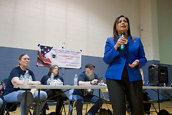 Maria Quiñones-Sanchez speaks as representatives of Safehouse react to questions and concerns during a community meeting at Heitzman Rec center, on Thursday. (Bastiaan Slabbers for WHYY)