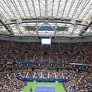 2017 U.S. Open Tennis Tournament - DAY TWO. A general view under the closed roof of Arthur Ashe Stadium showing Rafael Nadal of Spain in action against Dusan Lajovic of Serbia during the Men's Singles round one match at the US Open Tennis Tournament at the USTA Billie Jean King National Tennis Center on August 29, 2017 in Flushing, Queens, New York City.  (Photo by Tim Clayton/Corbis via Getty Images)