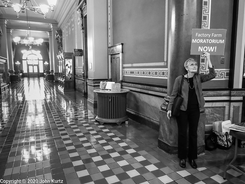 23 JANUARY 2020 - DES MOINES, IOWA: A woman stands near the rotunda of the Iowa State Capitol during a rally against factory farming. About 75 people, including farmers, environmental activists, and supporters of family farms, came to a protest in the rotunda of the state capitol in Des Moines. They are trying to pressure Iowa lawmakers to pass a moratorium against new factory farm construction in Iowa.     PHOTO BY JACK KURTZ