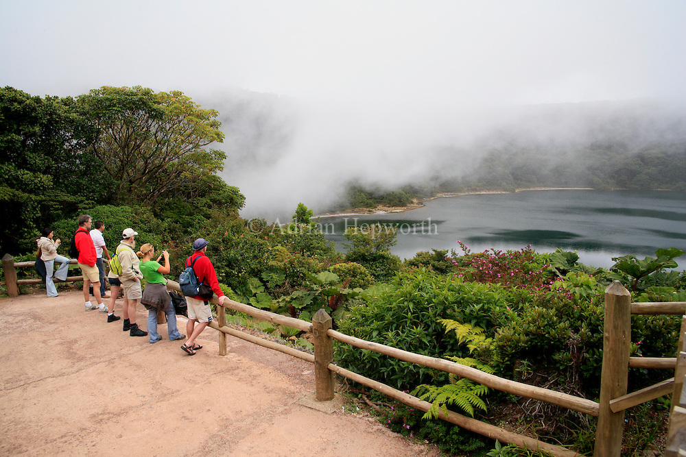 Tourists at Botos Lagoon, the extinct crater of Poas Volcano, Alajuela, Costa Rica.<br />