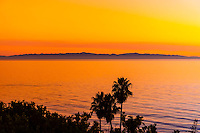 Sunset over the Pacific Ocean seen from the Mesa (with the Channel Islands in the background), Santa Barbara, California USA.