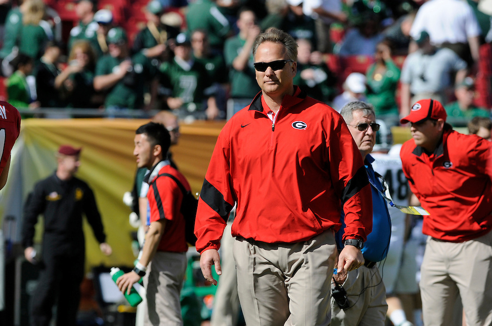 January 2, 2012: Head coach Mark Richt of Georgia watches his team warm up before the NCAA football game between the Michigan State Spartans and the Georgia Bulldogs at the 2012 Outback Bowl at Raymond James Stadium in Tampa, Florida.