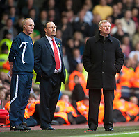 LIVERPOOL, ENGLAND - Sunday, October 25, 2009: Liverpool's manager Rafael Benitez and Manchester United's manager Alex Ferguson during the Premiership match at Anfield. (Photo by David Rawcliffe/Propaganda)