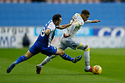 Derby County defender Jayden Bogle (37) goes past Wigan Athletic midfielder Gary Roberts (18)  during the EFL Sky Bet Championship match between Wigan Athletic and Derby County at the DW Stadium, Wigan, England on 8 December 2018.