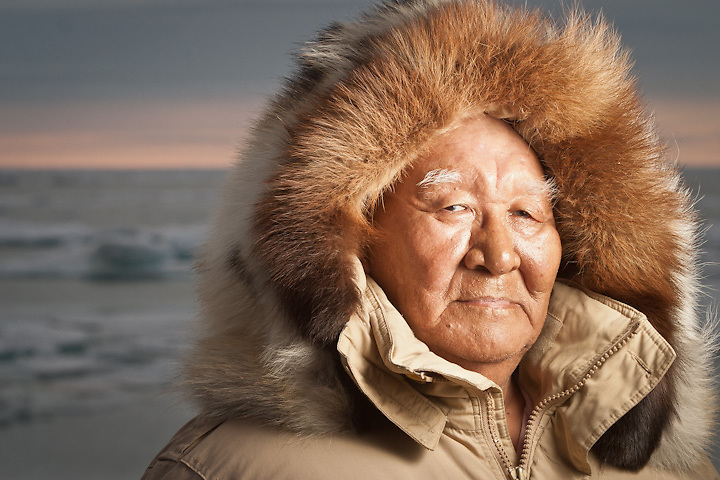 Inupiat elder and natural sciences advisor, Kenny Toovak, with fur ruff on the coast of the Arctic Ocean near Barrow, Alaska.
