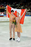 KELOWNA, BC - OCTOBER 26: Ice dance gold medalists Piper Gilles and Paul Poirier of Canada stand on the ice during medal ceremonies of Skate Canada International held at Prospera Place on October 26, 2019 in Kelowna, Canada. (Photo by Marissa Baecker/Shoot the Breeze)