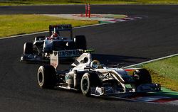 Motorsports / Formula 1: World Championship 2010, GP of Japan, 04 Nico Rosberg (GER, Mercedes GP Petronas), 03 Michael Schumacher (GER, Mercedes GP Petronas),