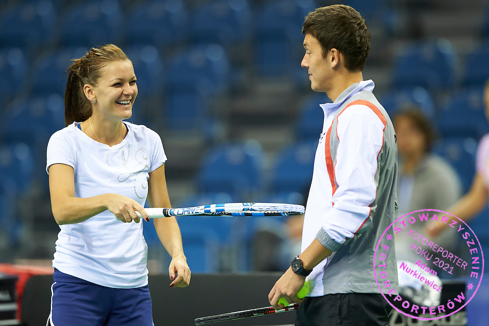 (L) Agnieszka Radwanska and (R) trainer assistant Dawid Celt both from Poland during official training session two days before the Fed Cup / World Group 1st round tennis match between Poland and Russia at Krakow Arena on February 5, 2015 in Cracow, Poland.<br /> <br /> Poland, Cracow, February 5, 2015<br /> <br /> Picture also available in RAW (NEF) or TIFF format on special request.<br /> <br /> For editorial use only. Any commercial or promotional use requires permission.<br /> <br /> Adam Nurkiewicz declares that he has no rights to the image of people at the photographs of his authorship.<br /> <br /> Mandatory credit:<br /> Photo by &copy; Adam Nurkiewicz / Mediasport