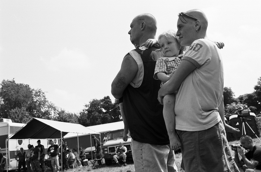 The Swanson family listen to World Church of the Creator leader Matt Hale at a White Pride Festival in Osceola, Indiana. (Photo by William B. Plowman)