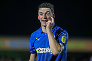 AFC Wimbledon midfielder Callum Reilly (33) pointing to his face during the EFL Sky Bet League 1 match between AFC Wimbledon and Doncaster Rovers at the Cherry Red Records Stadium, Kingston, England on 14 December 2019.