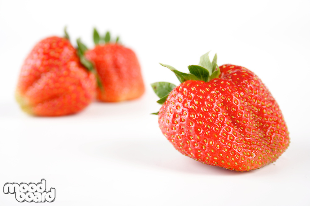 Close-up of strawberries on white background