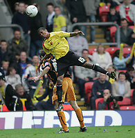 Photo: Lee Earle.<br /> Watford v Wolverhampton Wanderers. Coca Cola Championship. 29/10/2005. Watford's Ashley Young clashes with Maurice Ross.