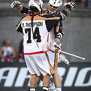 Joel White #11 of the Rochester Rattlers celebrates a goal with Miles Thompson #74 of the Rochester Rattlers during the game at Harvard Stadium on August 9, 2014 in Boston, Massachusetts. (Photo by Elan Kawesch)