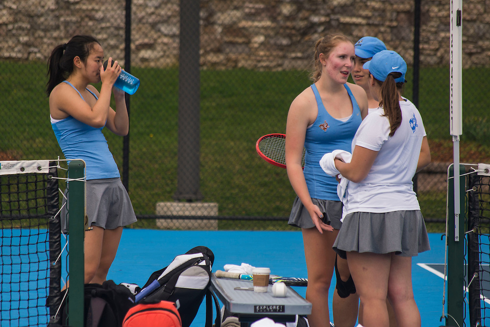 4/1/16 - Medford/Somerville, MA - Tufts players take a break during the Tufts women's tennis matches against Colby on the Voute Tennis Courts on Apr 1, 2016. (Ray Bernoff / The Tufts Daily)