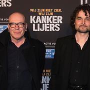 NLD/Amsterdam/20140210 - Filmpremiere Kankerlijers, Producent Burny Bos (L) en regisseur Lodewijk Crijns