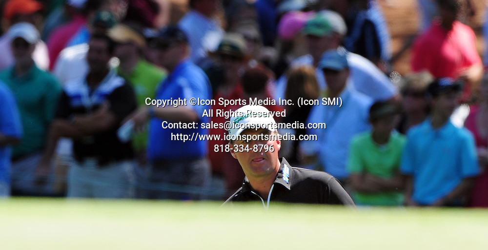 April 8, 2012 - Augusta, Georgia, U.S. - Peter Hanson looks at his lie on the third green during Sunday's final round of the 2012 Masters Tournament at Augusta National Golf Club on April 8, 2012, in Augusta, Ga.