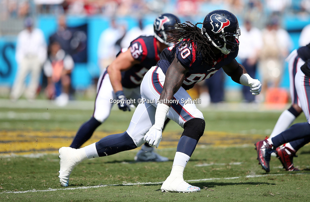 Houston Texans outside linebacker Jadeveon Clowney (90) rushes the quarterback during the 2015 NFL week 2 regular season football game against the Carolina Panthers on Sunday, Sept. 20, 2015 in Charlotte, N.C. The Panthers won the game 24-17. (©Paul Anthony Spinelli)
