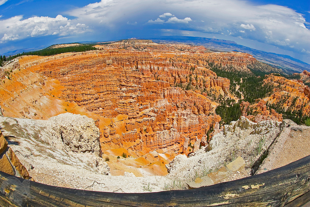 A view from the burned railing around Bryce Canyon, Utah, from the Sunset Point viewing area. The area was subjected to a forest fire, hence the burnt railing.
