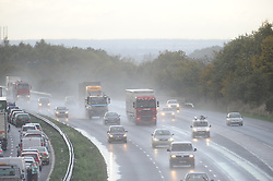 © Licensed to London News Pictures. 28/10/2013<br /> Traffic on the M25 at Swanley clockwise towards Sevenoaks this afternoon (28.10.2013) face bad driving conditions due to the weather.<br />  Photo credit :Grant Falvey/LNP