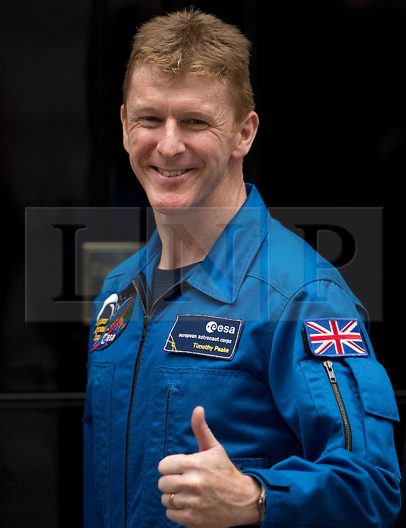 © London News Pictures. 20/05/2013 . London, UK.  Major TIM PEAKE, who is to become the first UK astronaut to visit the International Space Station (ISS),  posing for photographers as he enters 10 Downing Street in London to meet British Prime Minister David Cameron. Major Peake will become the first British astronaut in 20 years Photo credit : Ben Cawthra/LNP