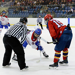 KINGSTON, ON  - FEB 22,  2018: Ontario Junior Hockey League game between the Kingston Voyageurs and the Wellington Dukes. Adam Kim #15 of the Kingston Voyageurs and Andrew Rinaldi #15 of the Wellington Dukes get set for the face-off during the first period.<br /> (Photo by Ian Dixon / OJHL Images)