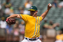 OAKLAND, CA - APRIL 13:  Eric Surkamp #48 of the Oakland Athletics pitches against the Los Angeles Angels of Anaheim during the first inning at the Coliseum on April 13, 2016 in Oakland, California. (Photo by Jason O. Watson/Getty Images) *** Local Caption *** Eric Surkamp