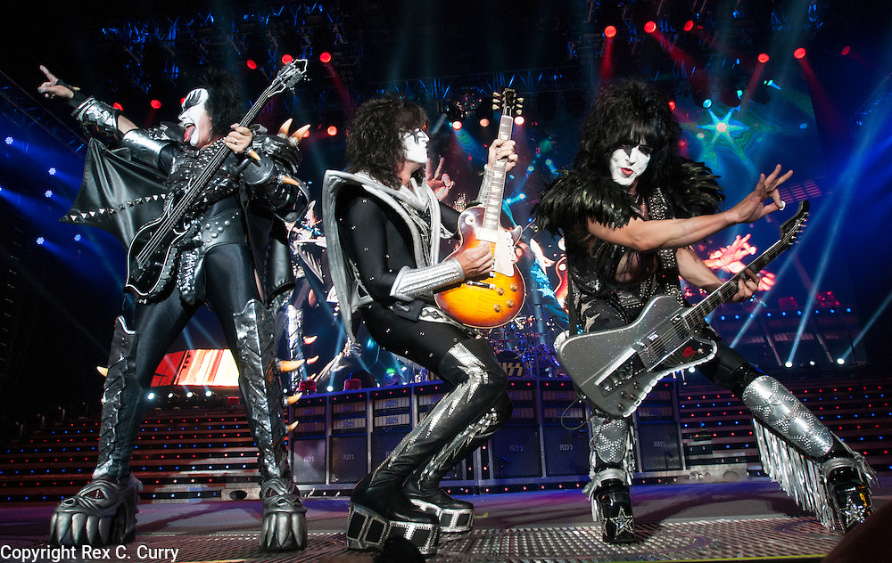 Gene Simmons, left, ommy Thayer, center, and Paul Stanley of Kiss performs at Gexa Energy Pavilion on Saturday, August 4, 2012......(Rex C. Curry/Special Contributor)