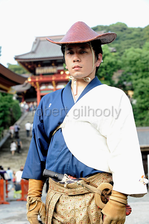 Tsuneharu Ogasawara, a 28-year-old neurology graduate student, shows off his traditional hunting garb after the Yabusame Shinji ritual in Kamakura, near Tokyo. Ogasawara us one of the chief participants in the ritual, which involves several riders on horseback firing arrows at targets while galloping at speed and dates back to the 12th century. It is  aimed at appeasing the numerous gods that guard Japan and was initiated by Kamakura shogun Minamoto no Yoritomo  in an attempt to improve his samurai warrior's appalling archery skills.