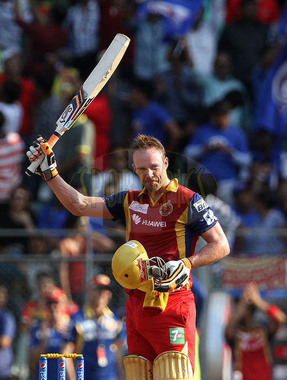 Royal Challengers Bangalore player AB De Villiers raises his bat after scoring a hundredduring match 46 of the Pepsi IPL 2015 (Indian Premier League) between The Mumbai Indians and The Royal Challengers Bangalore held at the Wankhede Stadium in Mumbai, India on the 10th May 2015.<br /> <br /> Photo by:  Vipin Pawar / SPORTZPICS / IPL