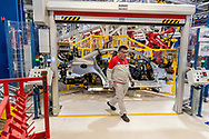 CASSINO, ITALY - NOVEMBER 24: An employee at work in the Body Shop where they assemble the Alfa Romeo Giulia in the Cassino Assembly Plant FCA Group on November 24, 2016 in Cassino, Italy. This is the most highly-automated area of the plant with nearly 1300 robots installed.
