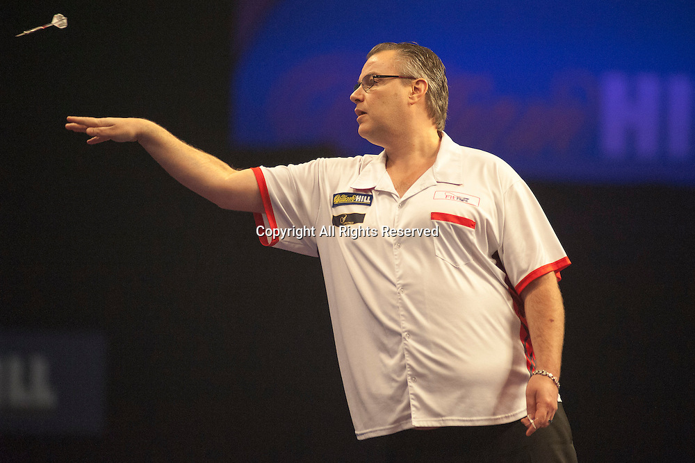 18.12.2014.  London, England.  William Hill PDC World Darts Championship.  John Part (30) [CAN] in action during his game with Keegan Brown [ENG].