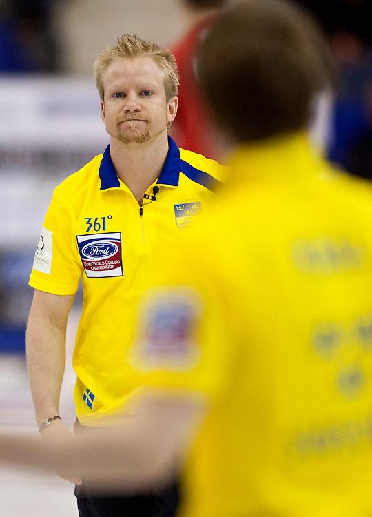 Swedish skip Niklas Edin, frowns after missing a shot during Sweden's bronze medal match against Norway at the Ford World Men's Curling Championships in Regina, Saskatchewan, April 10, 2011.<br /> AFP PHOTO/Geoff Robins