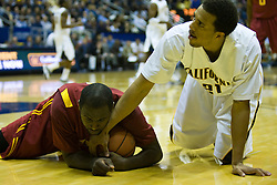 January 9, 2010; Berkeley, CA, USA;  Southern California Trojans forward Leonard Washington (4) grabs a loose ball from California Golden Bears forward Omondi Amoke (21) during the first half at the Haas Pavilion.  California defeated USC 67-59.