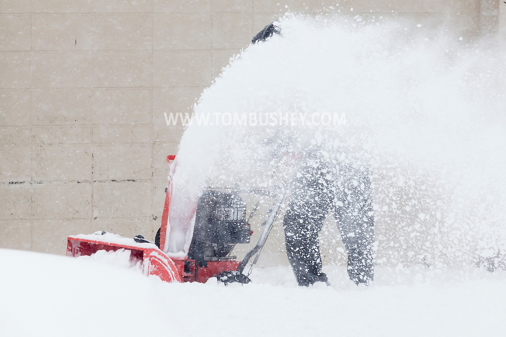 Middletown, New York - A man uses a snowblower at the Elks Club during a snowstorm on Feb. 9, 2017.