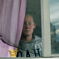 "Isabell Hoffman stands near her bedroom window at her family's house in Caldwell, Idaho. Earlier this month Hoffman, 16, woke up about 3 a.m. to Ricky E. Herrera, 26, falling on her bed after breaking into her bedroom window. Isabel  grabbed a pocket knife from her nightstand and told Herrera ""Get out or I'm going to stab you"". Herrera left that home, police say, and officers found and arrested him in a neighbors back yard. ""I didn't get much sleep after that. My adrenaline was pretty high "", Isabell added."
