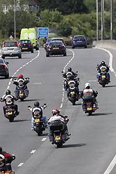 © Licensed to London News Pictures. 01/06/2019. Warninglid, UK. Large numbers of Hells Angels are seen heading to Brighton on the A23. Hundreds of Hells Angels are gathering in Surrey and Sussex to celebrate the 50th anniversary of the Untied Kingdom's first chapter of the notorious bike gang. Police have made more than 30 arrests. Photo credit: Peter Macdiarmid/LNP