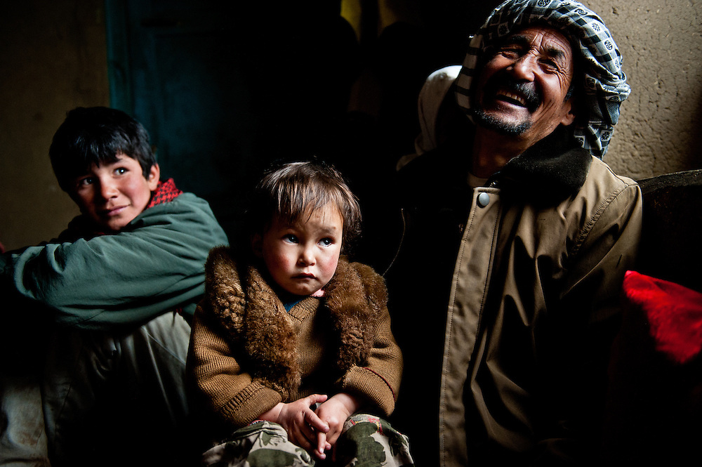 Abdul Ghani, 48, the village chief of Jawkar, holds his son Mohammad Reza, 3. Abdul Ghani hopes tourism development will bring money to his village, which is badly in need of better schools and electrical infrastructure.