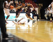 "Ole Miss' Nick Williams (20), teammate Dundrecous Nelson (5), and Louisiana Monroe's Christian Bibi Ndongo (5) and Charles Winborne (11) go for the ball at the C.M. ""Tad"" Smith Coliseum in Oxford, Miss. on Friday, November 11, 2011. Ole Miss won 60-38 in the season opener."