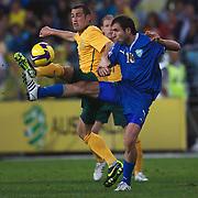 Carl Valeri challenges Timur Kadadze during the 2010 Fifa World Cup Asian Qualifying match between Australia and Uzbekistan at Stadium Australia in Sydney, Australia on April 01, 2009. Australia won the match 2-0.  Photo Tim Clayton