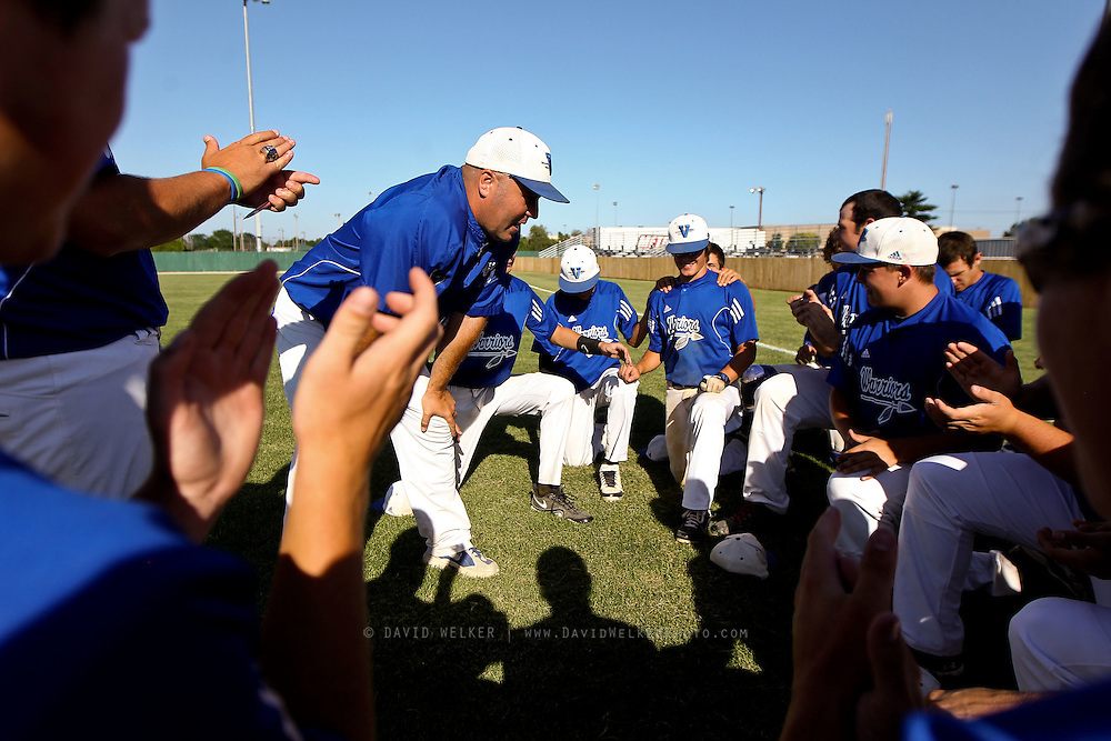 Head Coach Judd Naeger of the Valle Catholic Warriors talks with his team after a game against the Summit Christian Academy Eagles in the 2012 Missouri High School State Baseball Tournament at Meador Park on May 30, 2012 in Springfield, Missouri. (David Welker/TurfImages.com)..